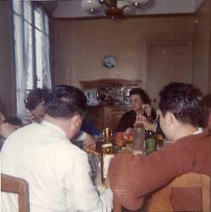 """Avril 1962  Un des derniers repas en Famille avant l'exode De G/D Premier plan de dos WERY Guy  CACCIUTTOLO Paul (fils) Au fond CACCIUTTOLO Lucie """"Lucienne"""""""