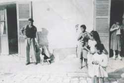 1951 - Devant la Douane Etienne CHARBONNIER avec son chien Yvette MARCOT qui tricote Kheira ? X X