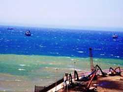 Port de TENES on charge de la ferraille  fer, acier, zinc, fonte ... destination l'Italie, l'Espagne, la Turquie ...